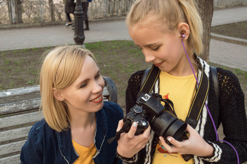 Teen daughter shows mom footage on the camera.