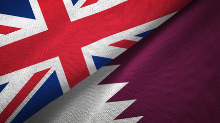 United Kingdom and Qatar two flags textile cloth, fabric texture