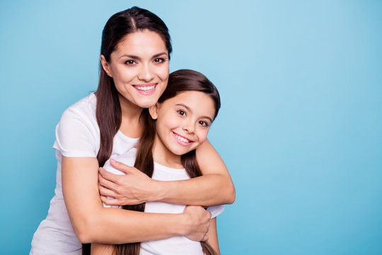Close up photo pretty two people brown haired mum small little daughter best friends stand hugging piggy back lovely nice free time rejoice wearing white t-shirts isolated on bright blue background