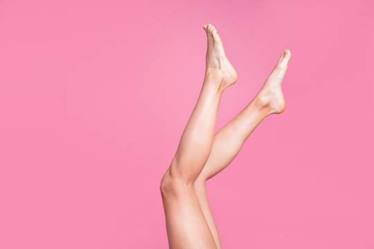 Cropped image view photo of nice long attractive feminine fit thin slim soft smooth shine clear clean shaven legs ad advert isolated over pink pastel background