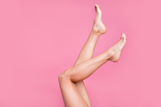 Cropped image view photo of nice long adorable attractive fit thin slim soft smooth shine clear clean shaven legs ad advert active walk life isolated over pink pastel background