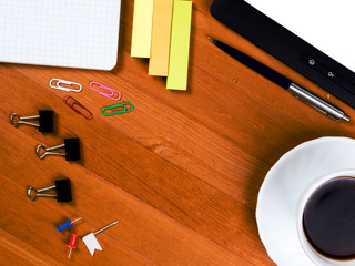 Top view on wooden table with office supplies