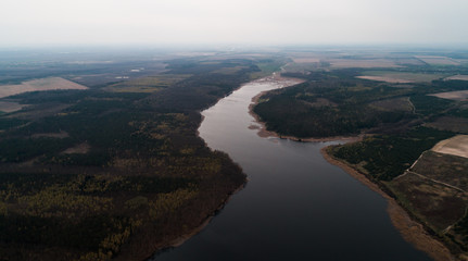 Aerial view of the autumn forest with river