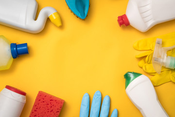 Cleaning supplies store. Online shopping. Household chemicals frame on yellow background.