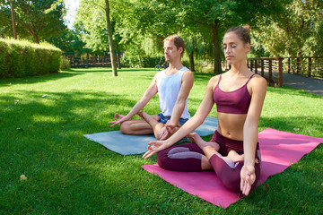 Couple practicing yoga outdoor
