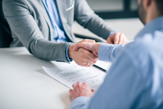 Business partnership concept. Cropped image of two businessmen handshake.