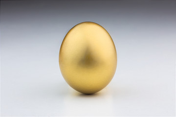 Golden egg isolated in a white background