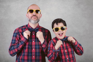 Father's day, father and son with tie and sunglasses