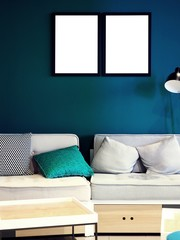 Mock-up, mockup exhibition, modern creative hipster living room, studio, office with sofa with pillows, couch and lamp, white empty photo frame on a solid color, green blue wall and white wooden desk
