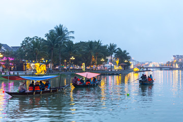 Boats on river in Hoi An old town in Vietnam