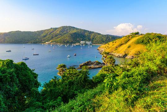 Tropical bay at Naiharn and Ao Sane beach with boats at windmill viewpoint, Paradise destination Phuket, Thailand