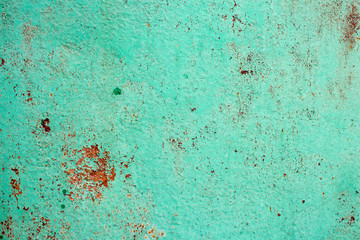 iron sheet in green paint and with rusty spots