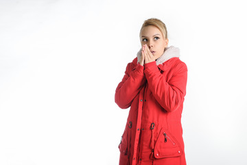 20-years blond girl in a red coat on a white background