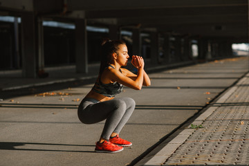 Young sports woman stretching outdoors