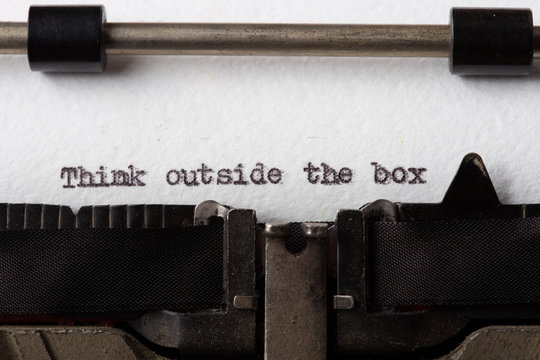 Think Outside The Box text on the typewriter