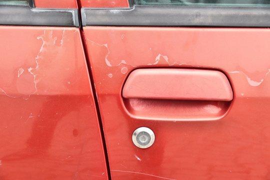 Peeling vehicle paint