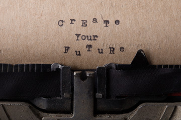 Create your future - text message on the typewriter close-up