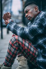 Young fashionable man posing for stylish urban photo shoot