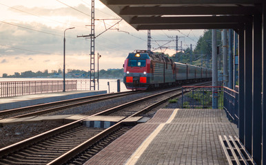 passenger train on the railway tracks approaching the station