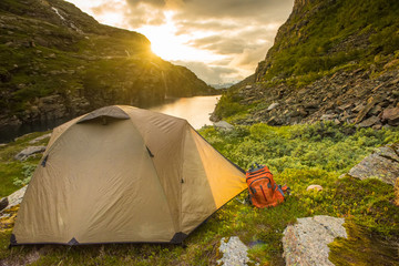 tourist tent near mountain lake, summertime sunset, Norway