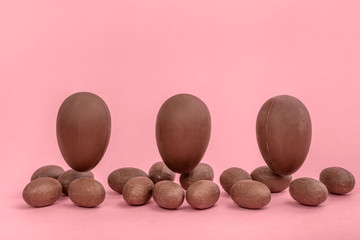 funny creative concept of flying Easter eggs on pink background, copy space