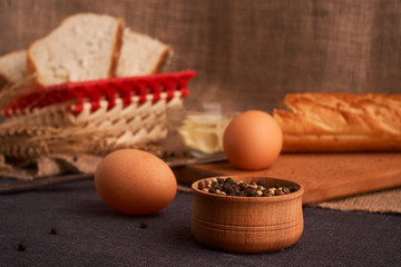 Different bread and wheat on the rustic table. Selective focus, close up