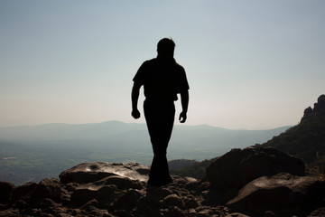 Man walking in the chasm of a viewpoint that is in a state of Mexico in the great hill of the orator