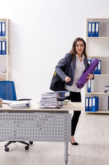 Female employee doing sport exercises in the office