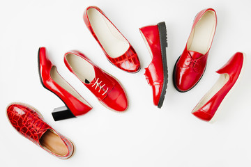 Wall Mural - Stylish female spring or autumn shoes in red colors. Beauty and fashion concept. Flat lay, top view