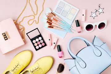 Wall Mural - Flat lay of female fashion accessories, makeup products and handbag on pastel color background. Beauty and fashion concept
