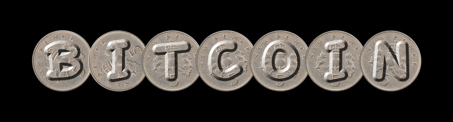 BITCOIN word with old coins on black background