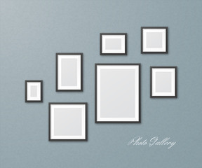Set of black photo frames of different sizes on textured wall. Vector realistic mockup of empty picture frames for design of gallery for painting or photos. Isolated from background.