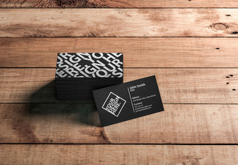 Stack of Black Business Cards on Wooden Surface Mockup