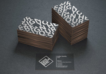 Two Stacks of Black Business Cards on a Textured Black Surface Mockup