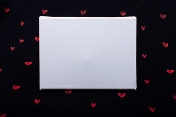 White canvas on black background with red hearts