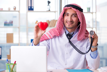 Arab doctor cardiologist working in the clinic