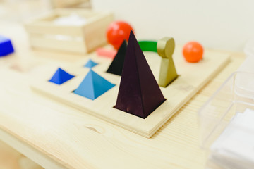 Montessori materials to learn geometry in a school.