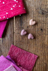 Fabric and hearts  on a wood table