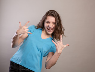 Woman in Blue Shirt Gesturing