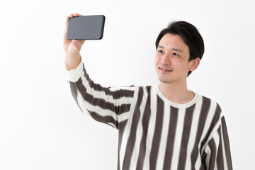 portrait of casual asian man on white background