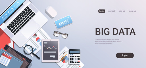 big data concept workplace desk with office stuff top angle view tablet laptop computer paper documents report finance graph flat copy space horizontal - fototapety na wymiar