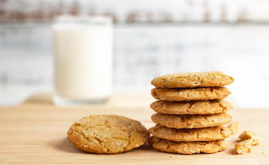 Homemade oatmeal cookies stacked on the brown cloth. Its are a nutrient-rich food associated with protein and fiber.