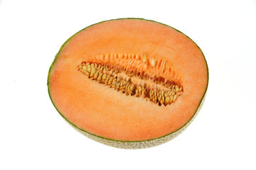 close up on fresh melon cut in half isolated on the white background