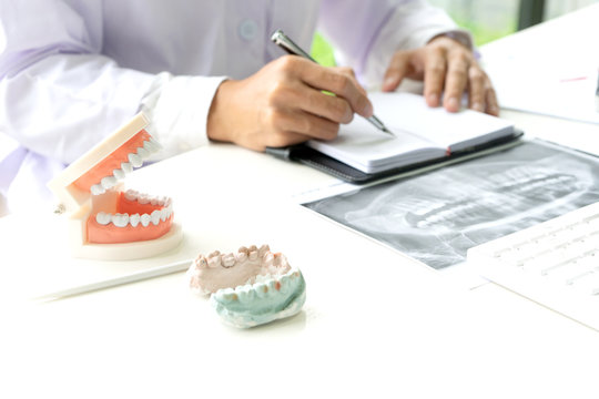 dentist work on the table with Denture