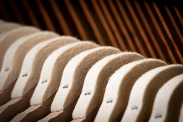Abstract closeup of the interior of an upright piano