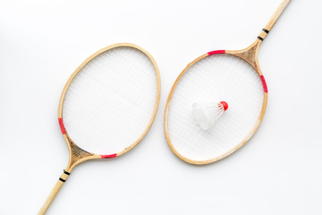 Badminton concept. Badminton rackets and shuttlecock on white background top view pattern
