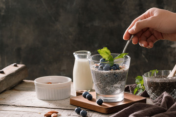 Chia pudding with berries and milk, sweet nourishing dessert, healthy breakfast superfood concept