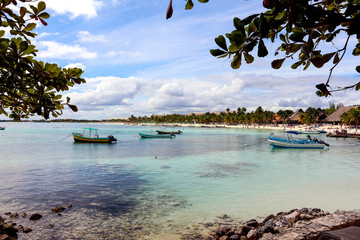 beautiful tropical ocean photography. blue clear water. sea sun and stones. boats floating in the bay. beach in mexico. clear sunny weather. beautiful landscape with the ocean