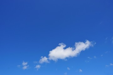 Beautiful nature of blue sky and clouds with the sun shining, sky background, cloudscape concept, Looking up