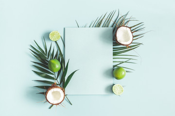 Summer composition. Tropical palm leaves, fruits, paper blank on pastel blue background. Summer concept. Flat lay, top view, copy space